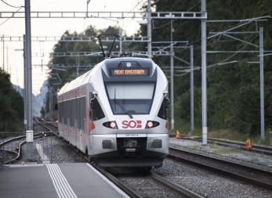 The train in which a man attacked other passengers stands at the station in Salez, Switzerland.
