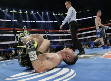 Liam Smith, left, lays on the mat after being knocked out by Canelo Alvarez fight during the ninth round.