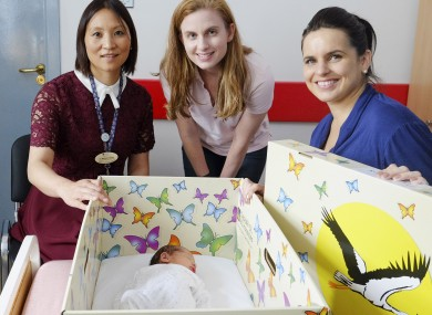 Dr Mendinaro Imcha, Consultant Obstetrician/Gynaecologist, University Maternity Hospital Limerick and Jennifer Clary, CEO The Baby Box Company with Lisa Healy with her brand new baby, Leah from Templemore, Co Tipperary.
