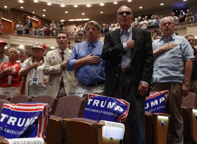 Trump supporters stand for the national anthem last Tuesday in Virginia.