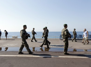 Soldiers patrol on the famed Promenade des Anglais in Nice days after July's terror attack.