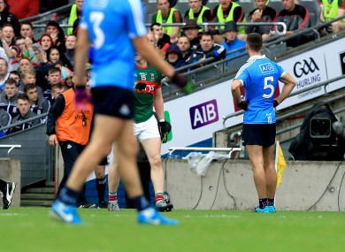 James McCarthy reacts to being shown a black card in the first-half of today's match in Croke Park.