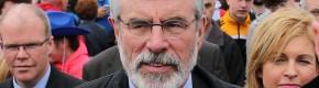 Gerry Adams is suing the BBC for alleging he approved murder of Denis Donaldson