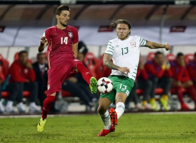 Serbia's Filip Mladenovic, left, battles for the ball with Ireland's Jeff Hendrick.