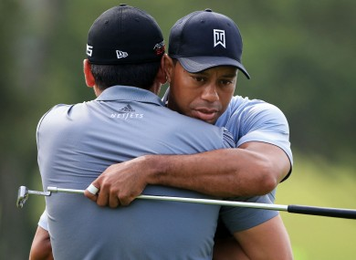 Tiger Woods embraces Jason Day in 2015