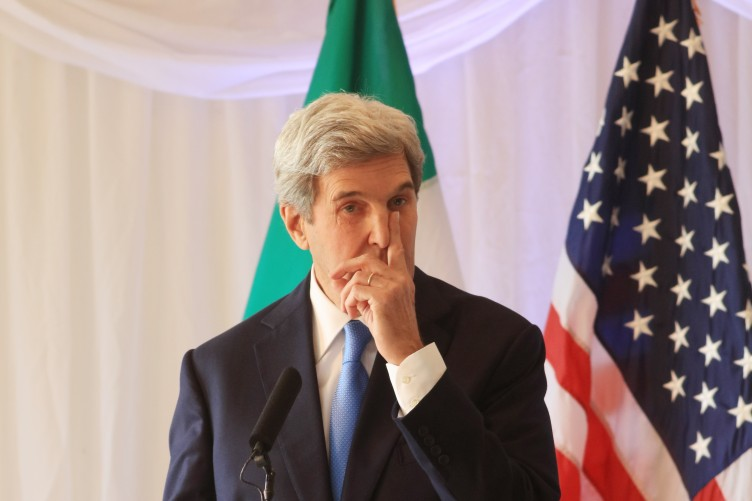 Kerry pissing on american flag