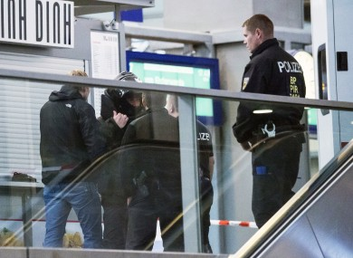 Police officers patrol the Central Station in the eastern city of Chemnitz.