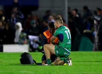 Matt Healy receives treatment after injuring his hand during Connacht's defeat of Edinburgh last Friday.