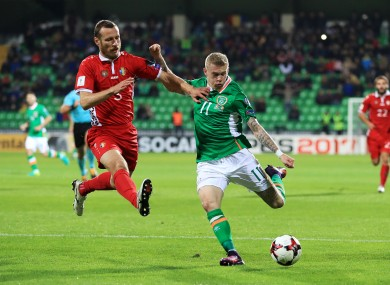 Moldova's Victor Golovatenco (left) and Republic of Ireland's James McClean compete for the ball.