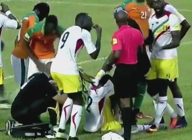 Mali's Moussa Doumbia receives treatment.