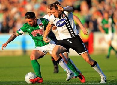 Dundalk defender Brian Gartland with Cork City striker Sean Maguire.