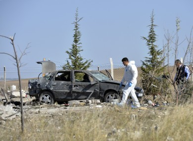 Police forensic officers work at the scene after suicide bombers blew themselves up in Haymana.