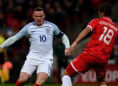 England captain Wayne Rooney in action against Malta