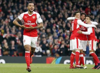 Arsenal's Theo Walcott, left, celebrates after scoring.