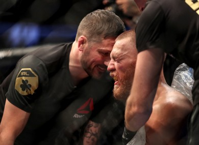Conor McGregor receives advice from his coach John Kavanagh in between rounds during his defeat of Nate Diaz.