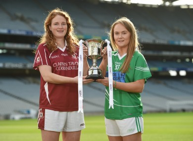 Duggan, left, with Shane O'Neills captain Louise Kenny. The sides meet in Parnell Park on Sunday (throw-in 1pm).