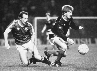 Scotland's Gordon Strachan, right, beats the Republic of Ireland's Liam Brady to the ball during the European Championship qualifier at Hampden Park, which Ireland won 1-0.