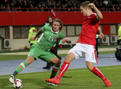 Ireland's Jeff Hendrick, left, and Austria's Kevin Wimmer challenge for the ball.