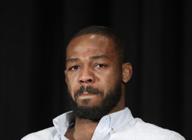 Mixed martial arts fighter Jon Jones cries as he speaks during a news conference last July.
