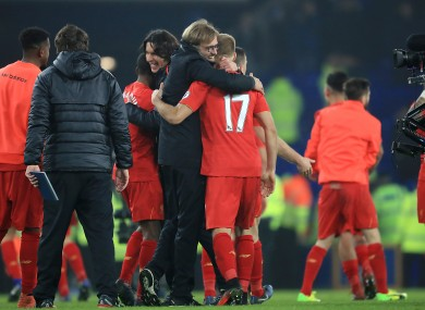 Liverpool manager Jurgen Klopp and Liverpool's Ragnar Klavan embrace after the final whistle.
