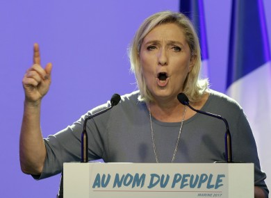 Le Pen delivers a speech in September.