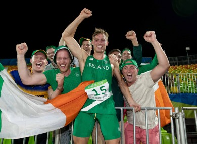 Ireland's Arthur Lanigan-O'Keeffe celebrates his eighth-placed finish with supporters.