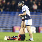 Na Piarsaigh's Cathal King comes to the assistance of Oulart-The Ballagh's Des Mythen.<span class=
