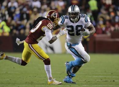 Washington Redskins defensive back Greg Toler (20) chases down Carolina Panthers running back Jonathan Stewart (28).