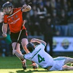 Oulart-the-Ballagh's Peter Murphy gets away from O'Loughlin Gaels Eddie Kearns.<span class=