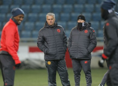 Manchester United's coach Jose Mourinho gets a closer look at the Odessa pitch.