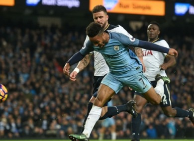 Man City's Raheem Sterling is impeded by Kyle Walker of Tottenham.