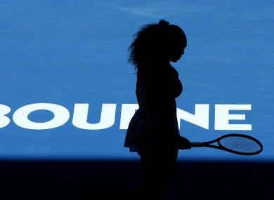 Serena Williams is silhouetted as she plays Britain's Johanna Konta.