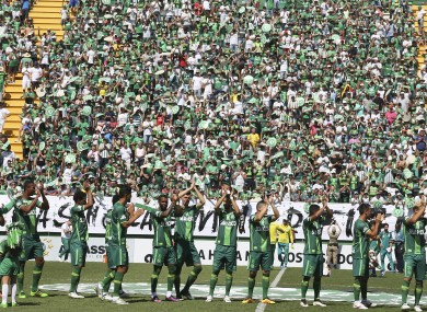 New Chapecoense players applaud prior to the friendly match against Palmeiras.