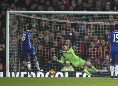 Chelsea's Diego Costa, left, has a penalty shot saved by Liverpool's goalkeeper Simon Mignolet.