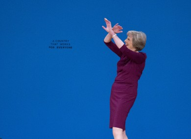 Prime Minister Theresa May waving to crowds at the recent Conservative party conference.