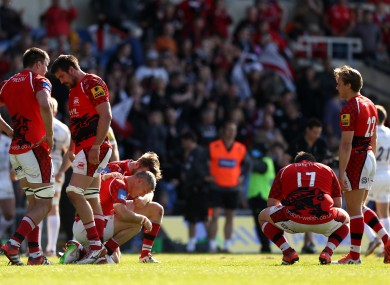 Players react after losing their 22nd game in the 22-match Aviva Premiership season in 2015.