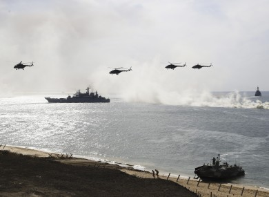 FILE: Russian navy ships and helicopters take a part in a landing operation during military drills at the Black Sea coast, Crimea.