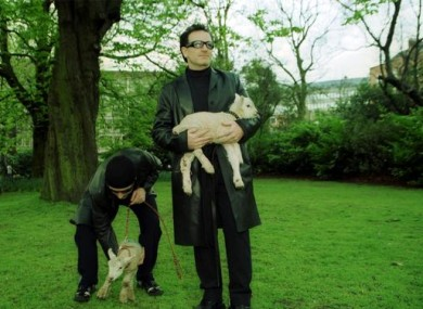 Bono and the Edge of U2, take two lambs to graze in Dublins St. Stephen's Green, to exercise the rights given them after they were awarded the Freedom of City.