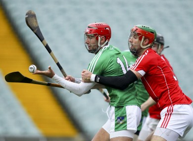 Barry Nash is challenged by Cork's Stephen McDonnell during the recent Co-Op Superstores.ie Munster senior hurling league final.