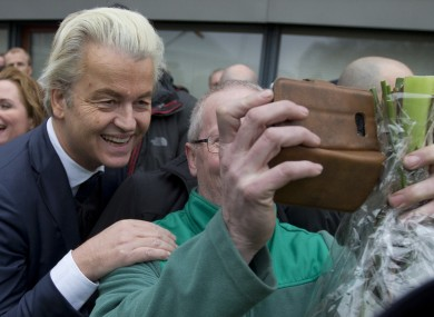 Geert Wilders posing for selfies during the launch of his campaign today.