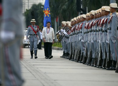 Philippine President Rodrigo Duterte reviews the troops.