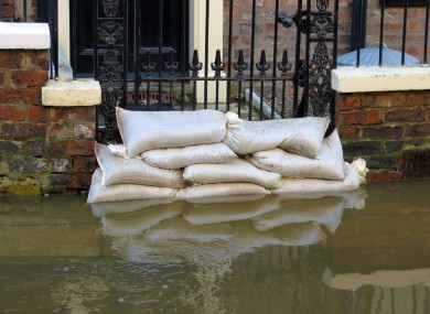 Mahon said he put sandbags around his home, but the water kept rising. It got to a stage where the family dog was swimming in the yard before being rescued (file photo).