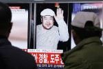 A TV screen showing a picture of Kim Jong Nam, who was assassinated last Monday