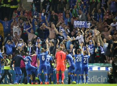 Genk players celebrate with their supporters after beating Cork back in August.