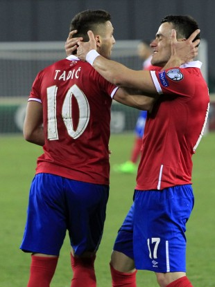 Serbia's Dusan Tadic and Filip Kostic celebrate one of the goals.
