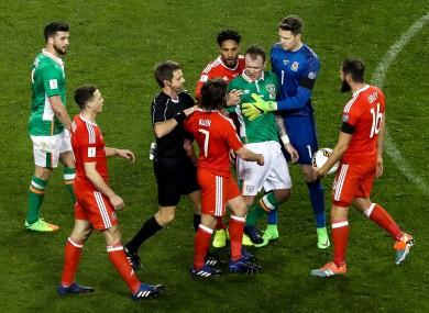 Ireland's Glenn Whelan has a tussle with Joe Allen of Wales.