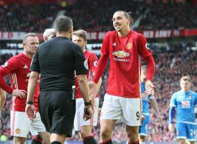 Manchester United's Zlatan Ibrahimovic (right) and Manchester United's Wayne Rooney (left) appeal to referee Kevin Friend (centre).