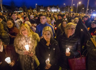 Mourners attend a vigil at the former site of the Andersontown Police Station in Belfast.