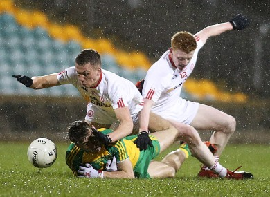 Donegal's Michael Carroll with Tyrone's Paul Donaghey and Nathan Donnelly.