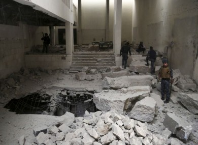 Iraqi federal police inspect the inside of Mosul's heavily damaged museum